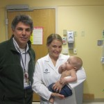 Dr. Tworetzsky and his Nurse Practioner, Terra holding Bronson
