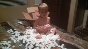 Playing with packing peanuts is so much fun!